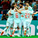 Diego Costa of Spain celebrates after scoring his team's first goal with team mates during the 2018 FIFA World Cup Russia group B match between Iran and Spain at Kazan Arena.