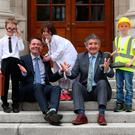 Finance Minister Paschal Donohoe and Training Minister John Halligan with twin brothers Elliot (left) and Theo Brophy and Hanna McCarthy at the launch of a CSO statistics on the labour market. Photo: Robbie Reynolds