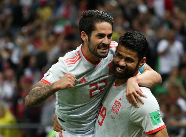 Spain's Diego Costa celebrates scoring his side's first goal with Isco. Photo: Reuters