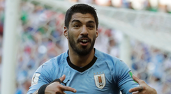 Uruguay's Luis Suarez celebrates scoring. Photo: AP