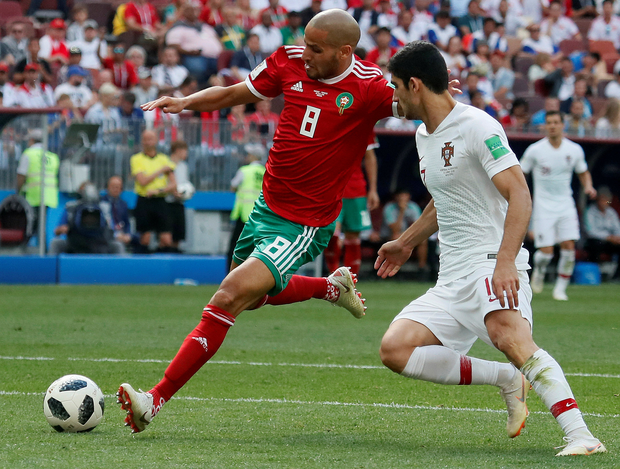Morocco's Karim El Ahmadi shoots ahead of Portugal's Goncalo Guedes. Photo: Reuters