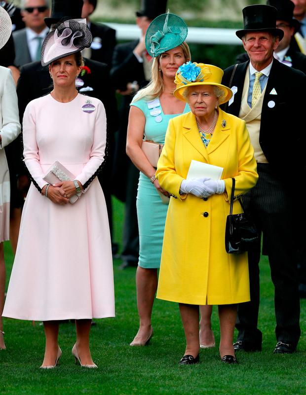 Sophie the Countess of Wessex (left) and Queen Elizabeth II watch the Wolferton Stakes during day one of Royal Ascot at Ascot Racecourse