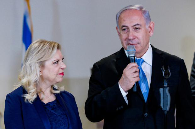 Israeli Prime Minister Benjamin Netanyahu and his wife Sara Netanyahu speak during the opening of a special exhibit on Jewish presence in Jerusalem at the United Nations Headquarters in New York City, U.S., March 8, 2018. REUTERS/Brendan McDermid/File Photo