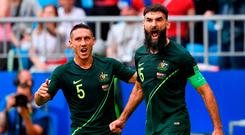 Australia's midfielder Mile Jedinak (R) celebrates scoring from the penalty spot for Australia's first goal to equalise 1-1 with Australia's defender Mark Milligan