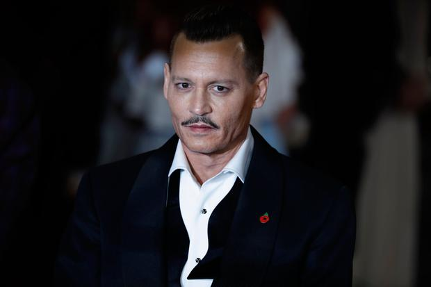 Johnny Depp responds to 'earpiece on set' reports
