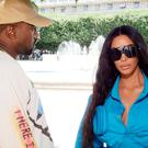 Kim Kardashian West and husband Kanye (Swan Gallet/WWD/REX/Shutterstock)