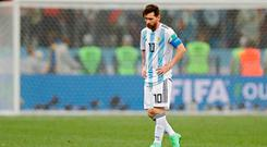 A dismayed Lionel Messi walks along the pitch at the end of the match. Photo: AP