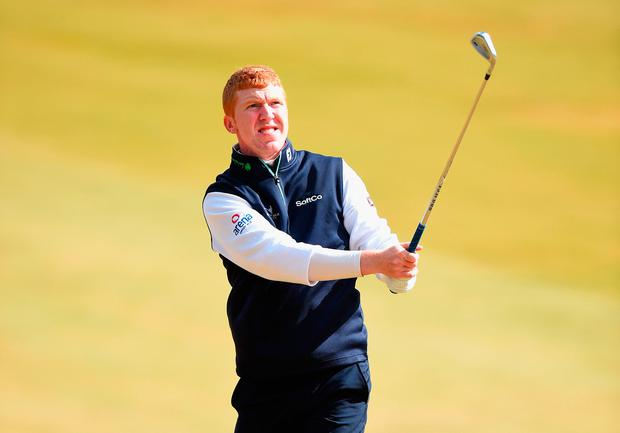 Gavin Moynihan plays a shot on the 1st fairway during Day One of the SSE Scottish Hydro Challenge. Photo: Getty Images