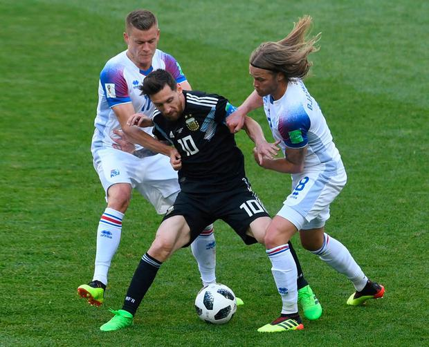 Lionel Messi (C) feels the squeeze from Birkir Bjarnason and Iceland's Alfred Finnbogason as Iceland belied their status in the game to frustrate Argentina in their opening World Cup game. Photo: Francisco Leong/AFP/Getty Images