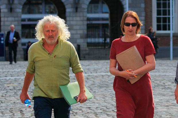 Independent TDs Clare Daly and Mick Wallace at the tribunal yesterday. Photo: Collins