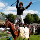 Frankie Dettori jumps off Stradivarius as he celebrates winning the 4.20 Gold Cup. Photo: Reuters