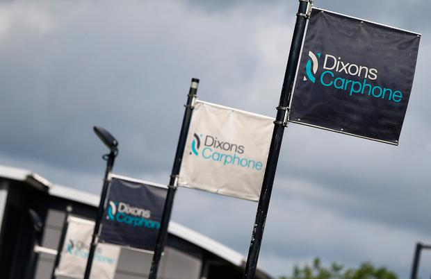 Signs display the logo of Dixons Carphone at the company headquarters in London. Photo: Reuters