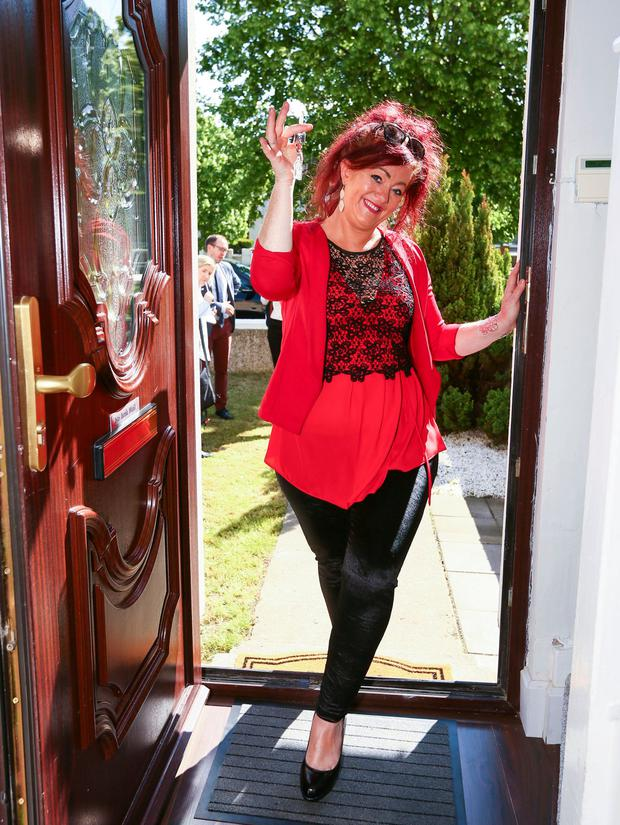 Toni Reid pictured with the key to her new Repair and Lease Scheme home. Photo: Colin O'Riordan