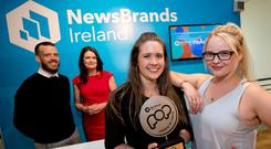 Chris Cashen, chair of the judges, and AnnMarie Lenihan, CEO of NewsBrands Ireland, with Tierna Brazil and Lauren Kavanagh from PHD Media, the winning team in the NewsBrands annual Power of Press media planning competition. Photo: Chris Bellew/Fennell Photography
