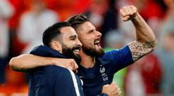 France's Olivier Giroud and Adil Rami celebrate after the match. Photo: Darren Staples/Reuters