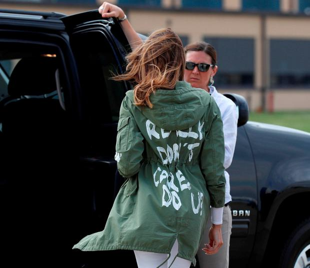 U.S. first lady Melania Trump walks to her motorcade wearing a Zara design jacket with the phrase