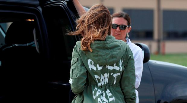 'I really don't care, do u?' - Melania dons jacket to visit migrant centre