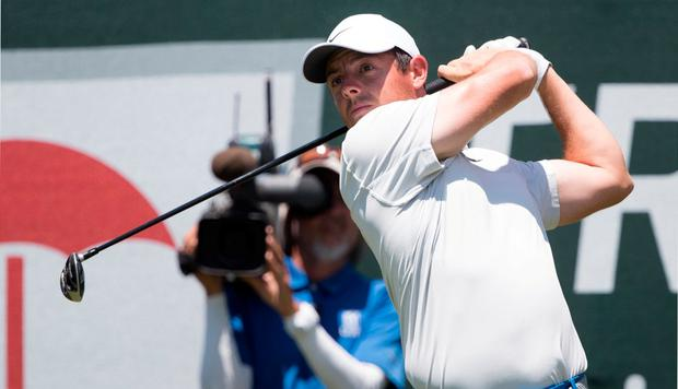 Rory McIlroy plays his shot from the first tee during the first round of the Travelers Championship at TPC River Highlands. Credit: Bill Streicher-USA TODAY Sports
