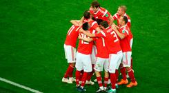 Russia celebrate their opener against Egypt. REUTERS/Michael Dalder