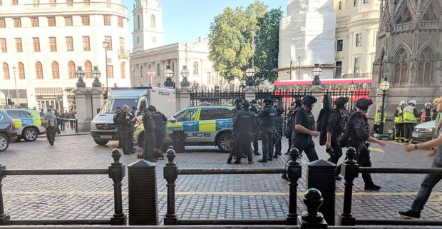 Picture taken with permission from the Twitter feed of Jack Davies showing police activity outside London's Charing Cross station where British Transport Police have detained a man following reports that someone was on the tracks claiming to have a bomb. Jack Davies / Twitter/PA Wire