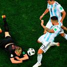 Argentina's defender Nicolas Otamendi (C) kicks the ball against Croatia's midfielder Ivan Rakitic last night
