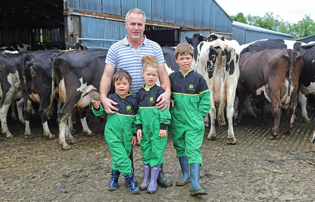 Anthony Leddy with his children Joshua, Jessica & Aiden on their farm in Milltown, Co. Cavan. Photo: Lorraine Teevan