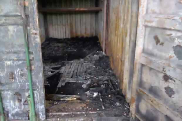 The burned-out container
