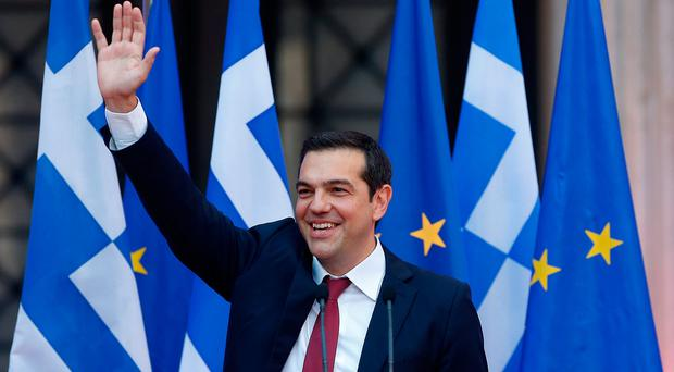 Greek Prime Minister Alexis Tsipras waves before a speech at the parliamentary group of Syriza and Independent Greeks in Athens. Photo: Reuters