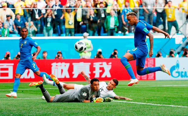 Brazil star Neymar pounces to score his team's second goal as the Costa Rica defence look on in despair. Photo: Max Rossi/Reuters