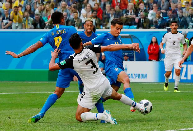 Brazil's Philippe Coutinho scores his side's first goal. Photo: Carlos Garcia Rawlins/Reuters