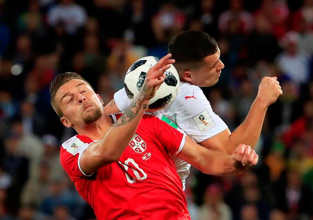 Serbia's Sergej Milinkovic-Savic in action with Switzerland's Granit Xhaka. Photo: Gonzalo Fuentes/Reuters