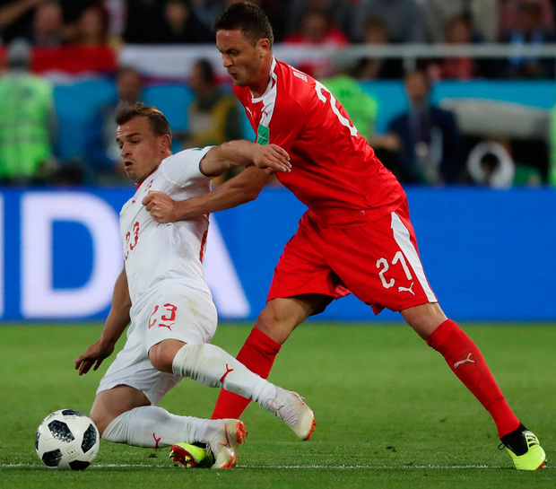 Swiss goal scorer Xherdan Shaqiri in action with Serbia's Nemanja Matic. Photo: Ricardo Moraes/Reuters