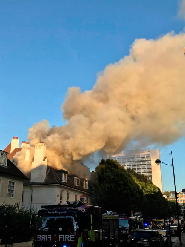 A fire is seen at the Somers Town Coffee House in London, Britain June 22, 2018 in this photo obtained from social media. NICO HOGG/via REUTERS