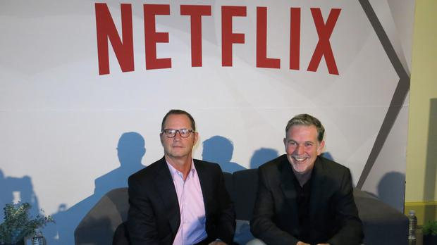 Reed Hastings, CEO and founder of Netflix, right, sits with Jonathan Friedland (Berenice Bautista/AP)