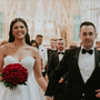 Irish model Tia Duffy and DJ Hickey walk down the aisle after tying the knot. Photo: Emma Russell