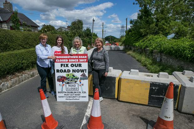 Local residents Margaret Kearney, Stephanie O'Toole, Miriam Mason and Valerie Keogh who are affected due to the closed-off Edmondstown Road (Photo: Kyran O'Brien)
