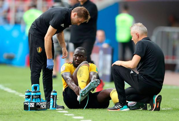 Belgium's Romelu Lukaku receives medical attention REUTERS/Carl Recine