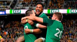 Ireland players, from left, Jonathan Sexton, Bundee Aki, and Jordi Murphy celebrate following the 2018 Mitsubishi Estate Ireland Series 3rd Test match between Australia and Ireland at Allianz Stadium in Sydney, Australia. Photo by Brendan Moran/Sportsfile