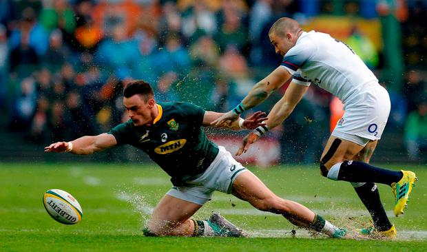 South Africa's wing Jessie Kriel (L) is tackled by England full-back Mike Brown (R) during the rugby union Test match between South Africa and England at Newlands Rugby Stadium in Cape Town on June 23, 2018. / AFP PHOTO / GIANLUIGI GUERCIAGIANLUIGI GUERCIA/AFP/Getty Images