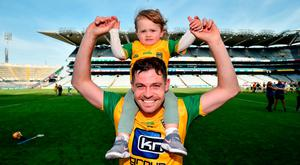 Declan Coulter of Donegal celebrates with his daughter Lara, age 1, following the Nicky Rackard Cup Final match between Donegal and Warwickshire at Croke Park in Dublin. Photo by David Fitzgerald/Sportsfile