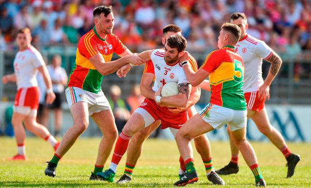 Ronan McNamee of Tyrone in action against Eoghan Ruth, Shane Redmond and Jordan Morrissey of Carlow during the GAA Football All-Ireland Senior Championship Round 2 match between Carlow and Tyrone at Netwatch Cullen Park in Carlow. Photo by Matt Browne/Sportsfile