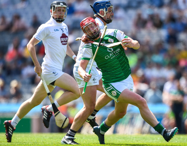 Colin Nelson of London is tackled by Kildare's Mark Grace during the Christy Ring Cup final. Photo: Sportsfile
