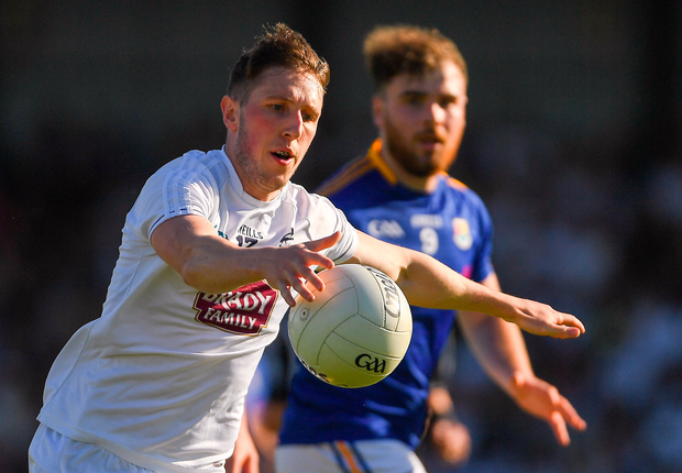 Kildare's Neil Flynn of Kildare shoots as Longford's Conor Berry watches on. Photo: Sportsfile