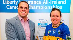 Michael Skelton of Liberty Insurance hands Cáit Devane of Tipperary the player of the match award. Picture: INPHO/Lorraine O'Sullivan