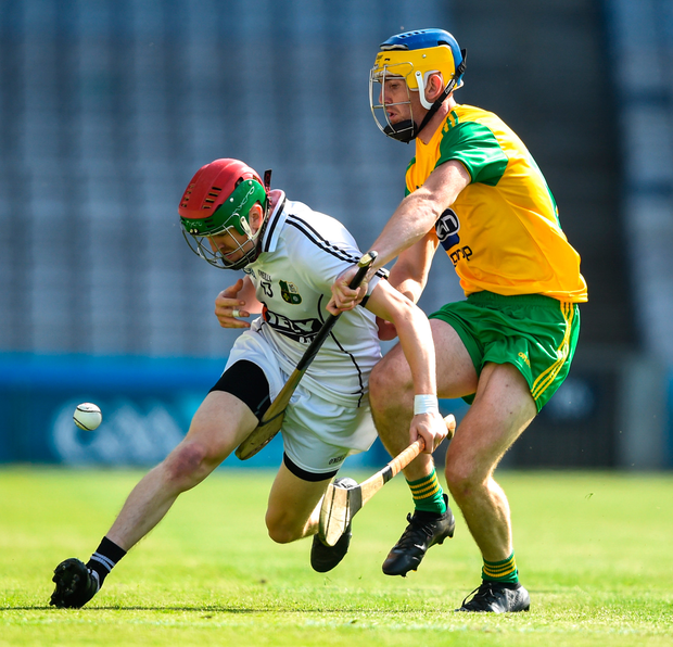 Donegal's Ronan McDermott tackles Warwickshire's Kelvin Magee. Photo: Sportsfile