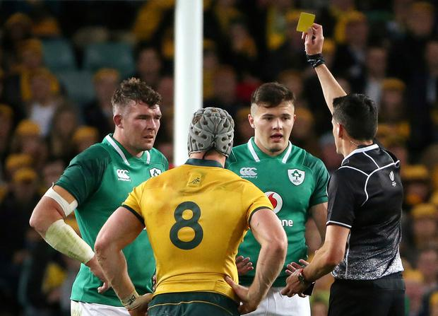 Ireland's Jacob Stockdale (second right) is shown a yellow card. Photo: AP