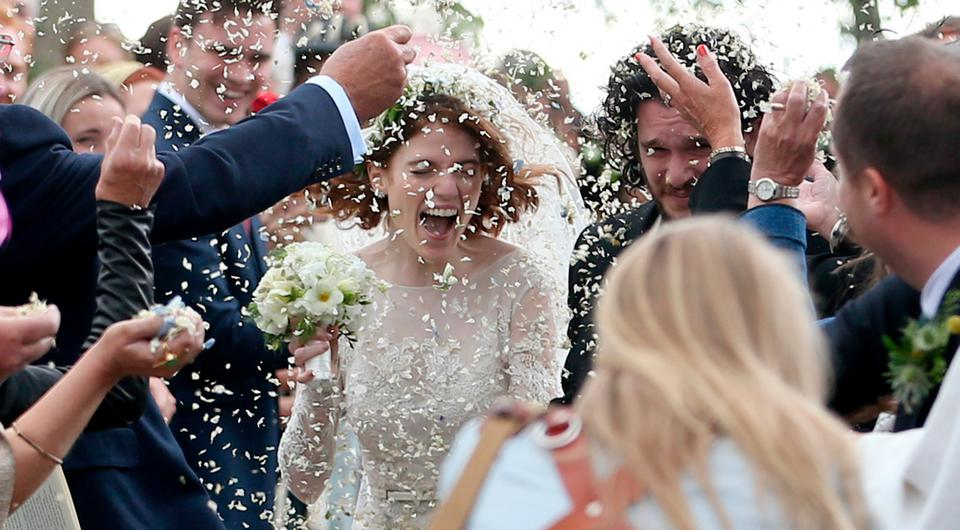 Kit Harington and Rose Leslie at Rayne Church, Kirkton of Rayne in Aberdeenshire, getting covered in confetti after their wedding. Photo: Jane Barlow/PA Wire