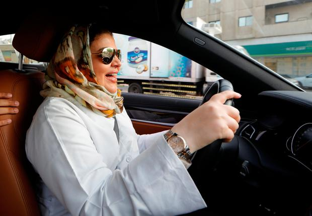 Samira al-Ghamdi, a practicing psychologist, reacts as she drives to work in Jeddah, Saudi Arabia June 24, 2018. REUTERS/Zohra Bensemra