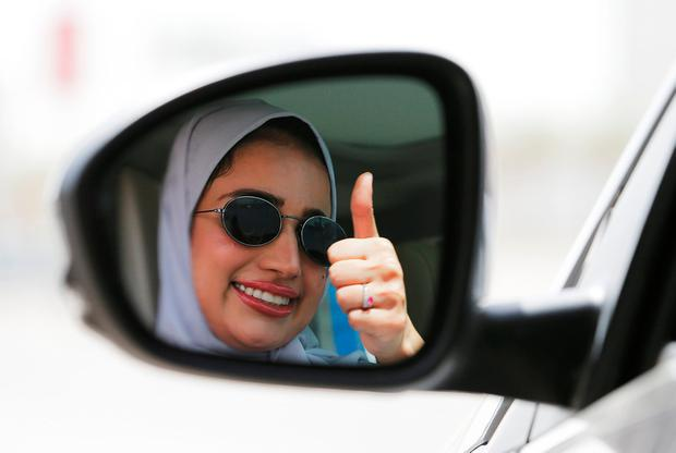 Zuhoor Assiri gestures as she drives her car in Dhahran, Saudi Arabia, June 24, 2018. REUTERS/Hamad I Mohammed