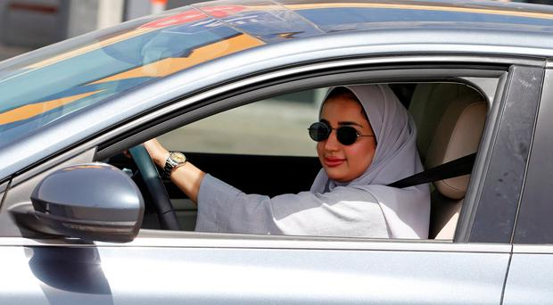 Male drivers 'supportive and cheering' as women take to the roads for the first time in Saudi Arabia